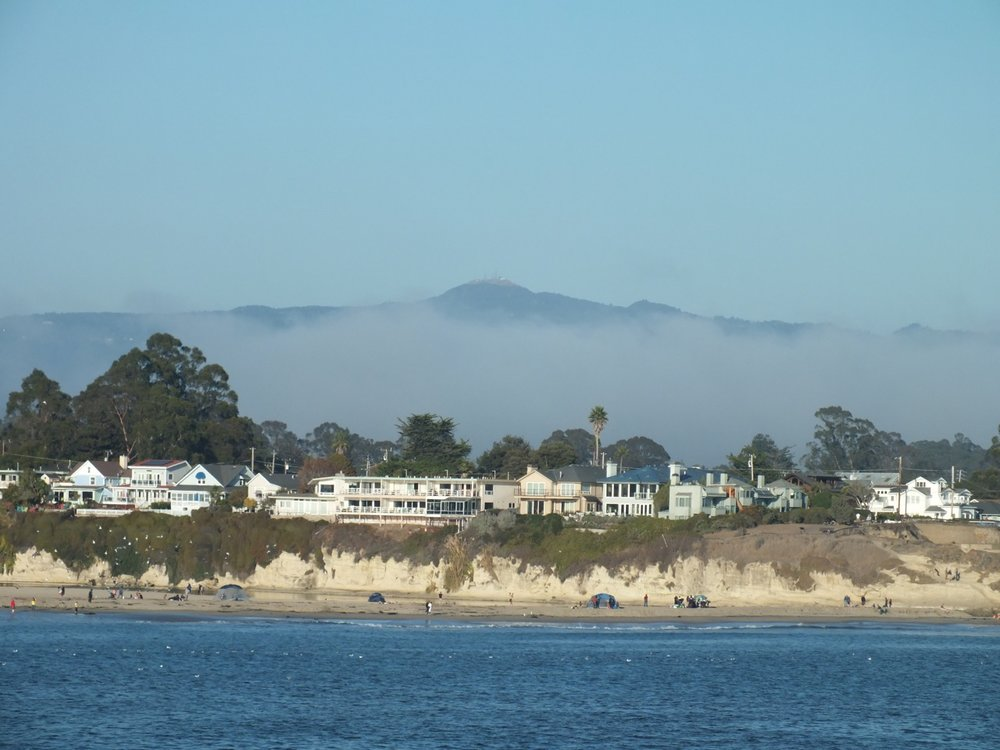 Loma Prieta shrouded in fog from Santa Cruz Wharf