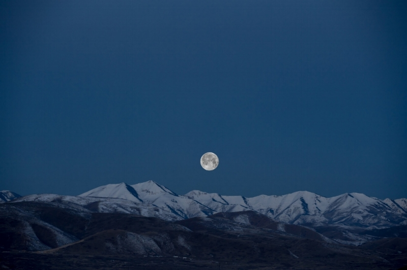 benjamin-child-full moon over mountains.jpg