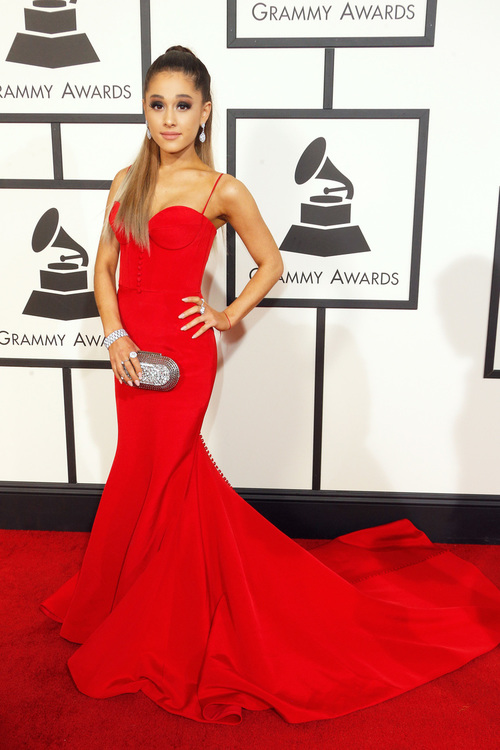 Pop Superstar; Ariana Grande was Red hot on the Red Carpet in a Romona Keveža at the 58th annual Grammy Awards.