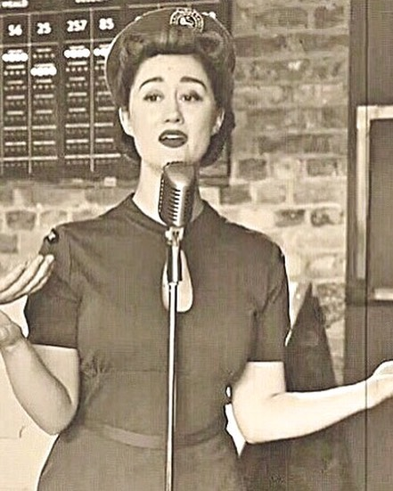 A video still of Bridgette, from our recent live performance of Don't Sit Under the Apple Tree, performed in and captured by the wonderful @escapeplanltd 1940's escape room! Watch the full video on youtube! 💋 #thebelladonnabrigade #escapeplan #vintagehair #1940s #vintagemusic #vintageclothing #wvs #womenofworldwar2 #victoryrolls #battleofbritain #ww2 #singers #singer #band #eventprofs #escaperoom