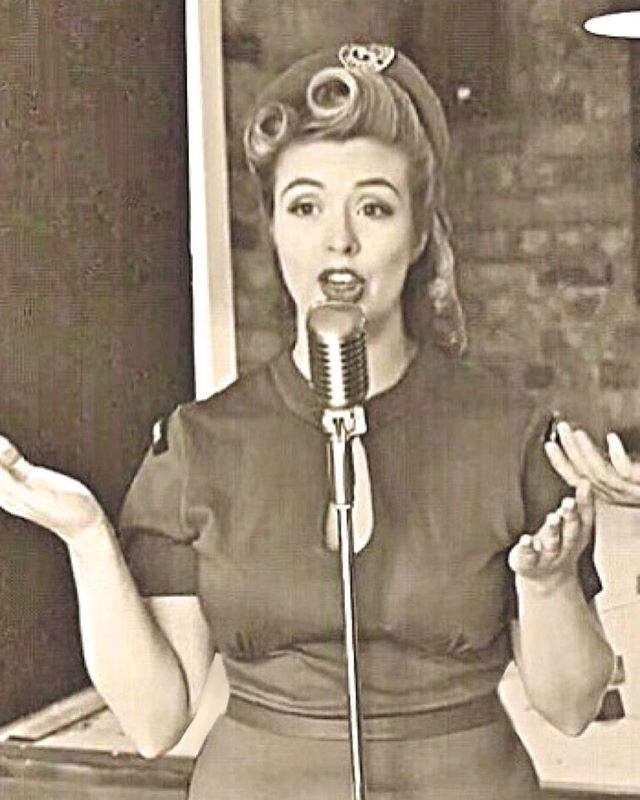 A video still of Birdie, from our recent live performance of Don't Sit Under the Apple Tree, performed in and captured by the wonderful @escapeplanltd 1940's escape room! Watch the full video on youtube! 💋 #thebelladonnabrigade #escapeplan #vintagehair #1940s #vintagemusic #vintageclothing #wvs #womenofworldwar2 #victoryrolls #battleofbritain #ww2 #singers #singer #band #eventprofs #escaperoom