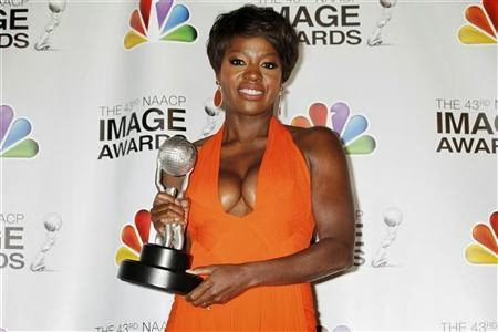 Actress Viola Davis poses with the Image Award she won as best actress in a motion picture for her role in ''The Help'' at the 43rd NAACP Image Awards in Los Angeles, California February 17, 2012. CREDIT: REUTERS/FRED PROUSER