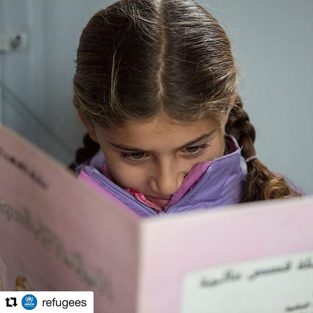 #images4change #Repost @refugees // Zeinab reads her favourite book, Snow White and the Seven Dwarfs, at the library at Filipadia camp on the Greek mainland. What is YOUR favorite book? 📚 . The library in which Zeinab reads came to be because refugees in the camp identified the need for a place to occupy children's time and help peaceful coexistence in the camp. © UNHCR/Yorgos Kyvernitis #Greece#SyrianRefugee #Syria #Books #Educations#Literature #Children #WithRefugees