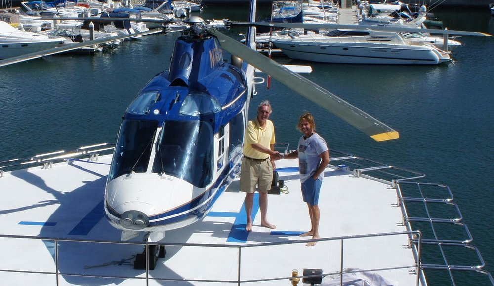 PJB III on yacht with helicopter.jpg