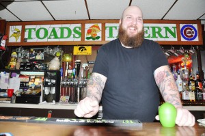Aaron Forney stands at your service at 6-foot, 8-inches, yet you'd be pressed to find a friendlier bartender anywhere.