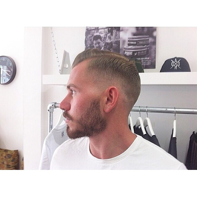 A very clean cut by @satinxblack from @aono_barbershop's talented crew..styled using @uppercutdeluxe www.thepomadeshop.com.au #pomade #uppercut #menssryle #mensgrooming #thepomadeshop #dapper #sidepart #barberlife