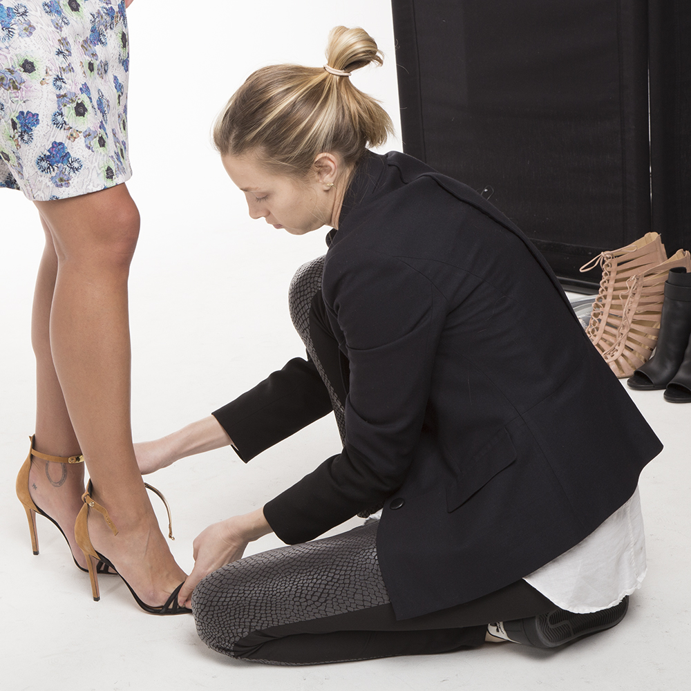 Whitney fixing some shoes