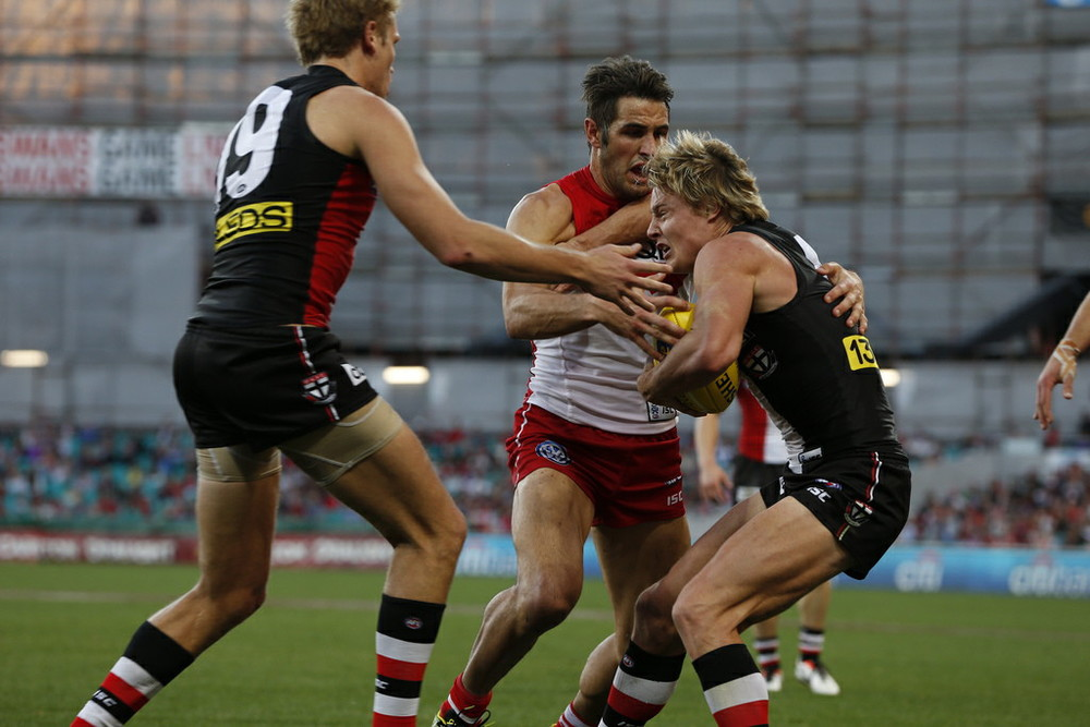 Josh Kennedy from the Swans lays another tackle