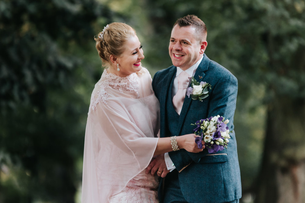 The bride and groom having a moment of laughter after their wedding ceremony in Lichfield.