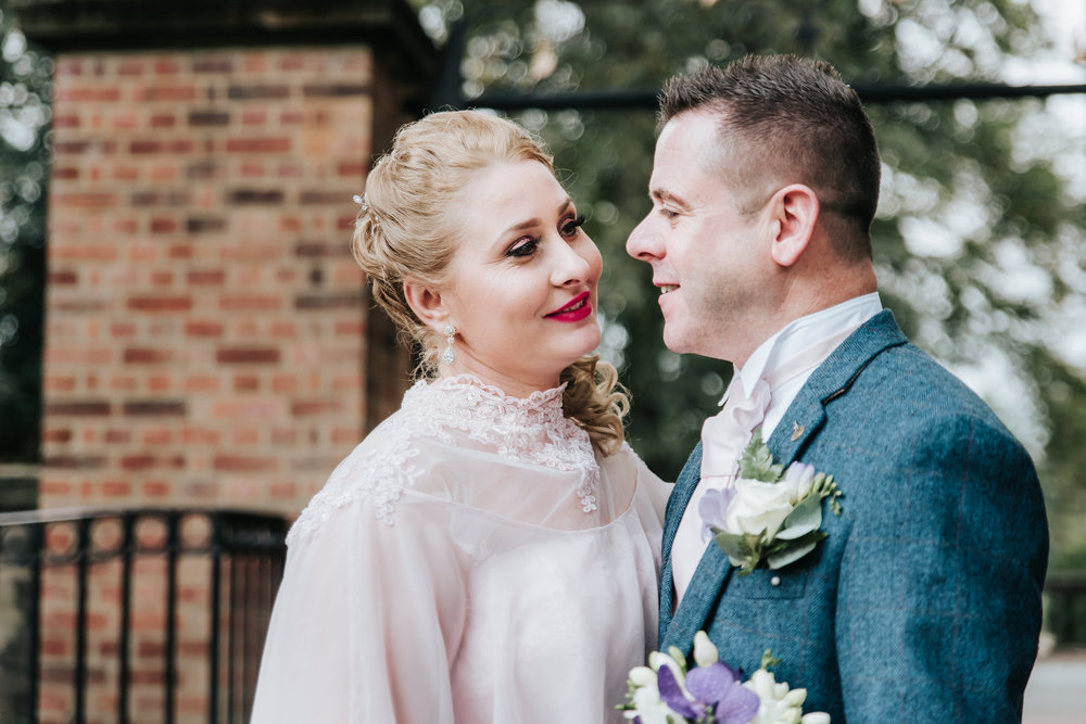 wedding-photos-bride-smiling-at-groom-leamington-spa-wedding-photographer