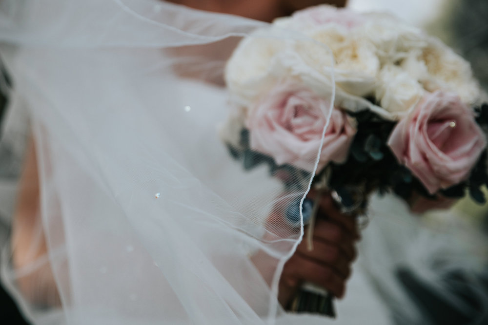 Beautiful bridal Bouquet by Rose Hamson and veil flowing in the wind.