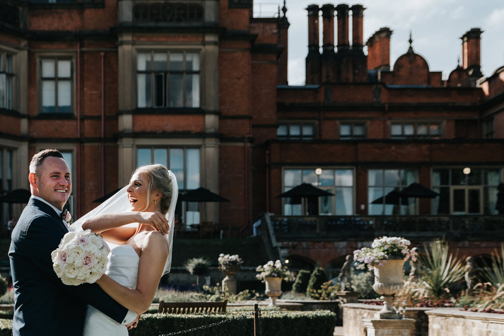 I + T share a moment of laughter on their sunny wedding day at the Welcombe Hotel in Stratford.