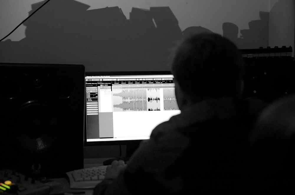 Late-night studio session with Tommy messing with the track.