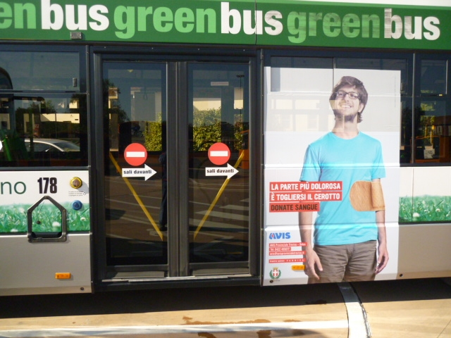Green Bus with poster