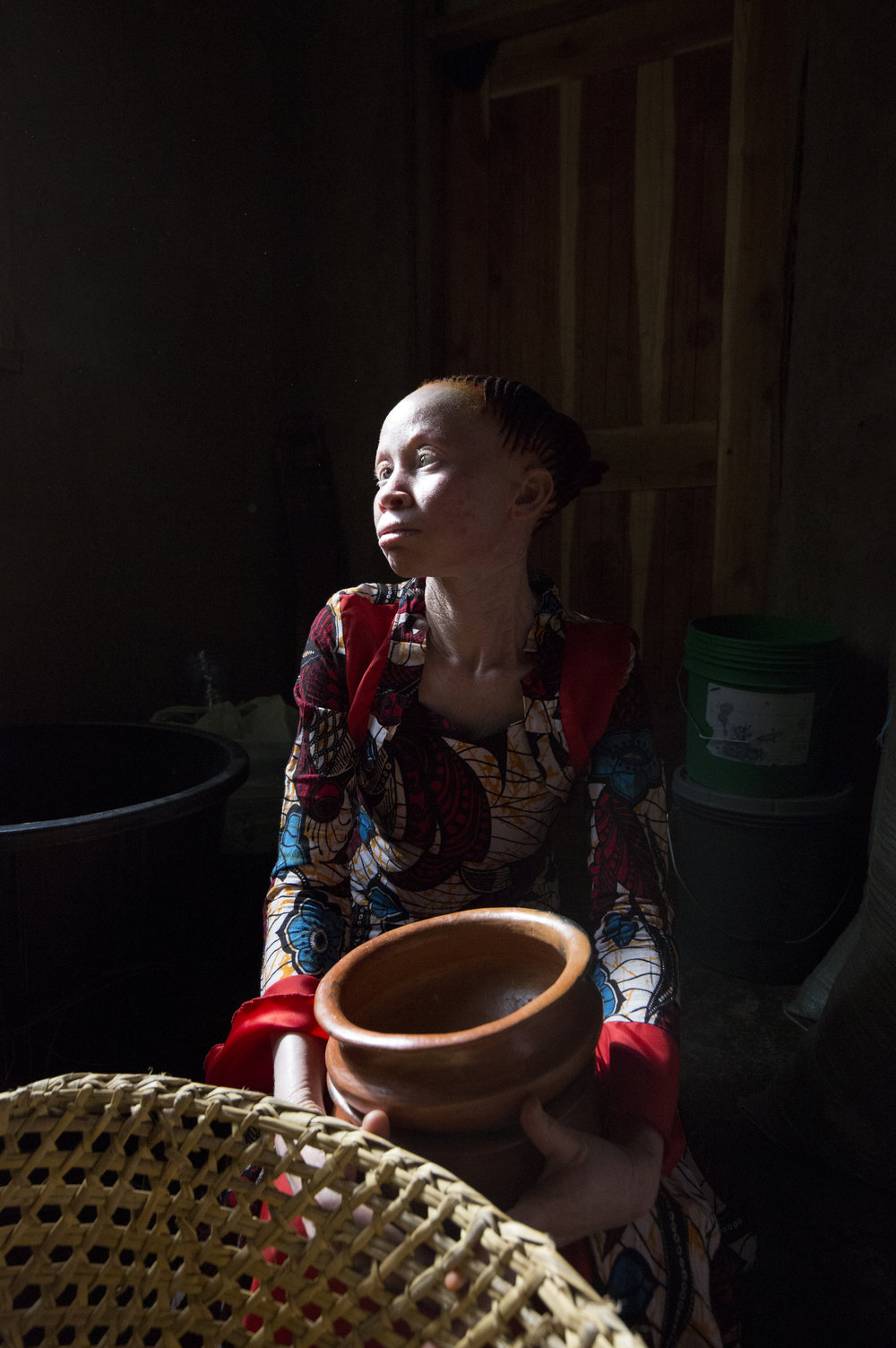 "Neema starts her own Pottery Business with the help of Charity Standing Voice. ""I make pots, stoves, and other kitchen utensils. My business does well. I am proud of the talent God has given me; it makes others realise that even a person with albinism can make it in this world."""