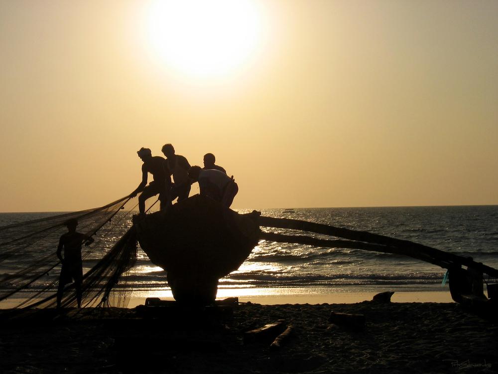 Silhouetted Fishermen In Goa