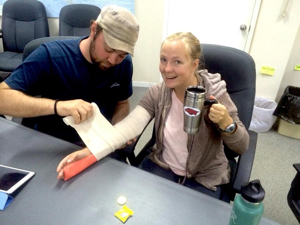 "Putting a splint on Lael's ""broken"" arm..."