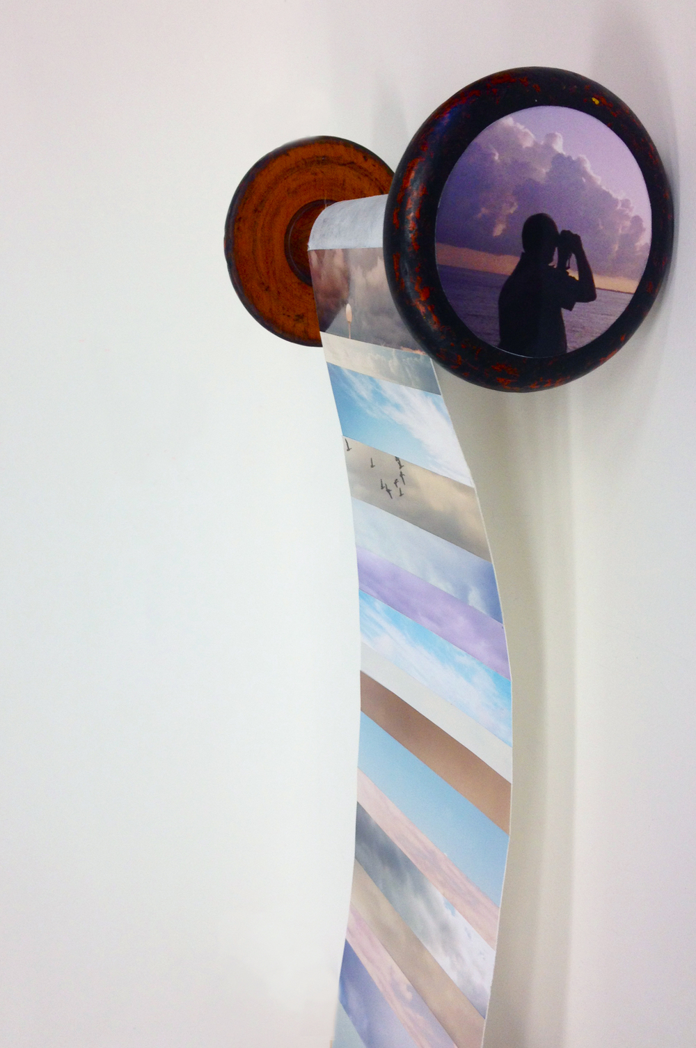 Sky Scroll, from the series Larry's Life, 2013, Re-purposed photographic prints and vintage spool. 10-inches X 4-feet.