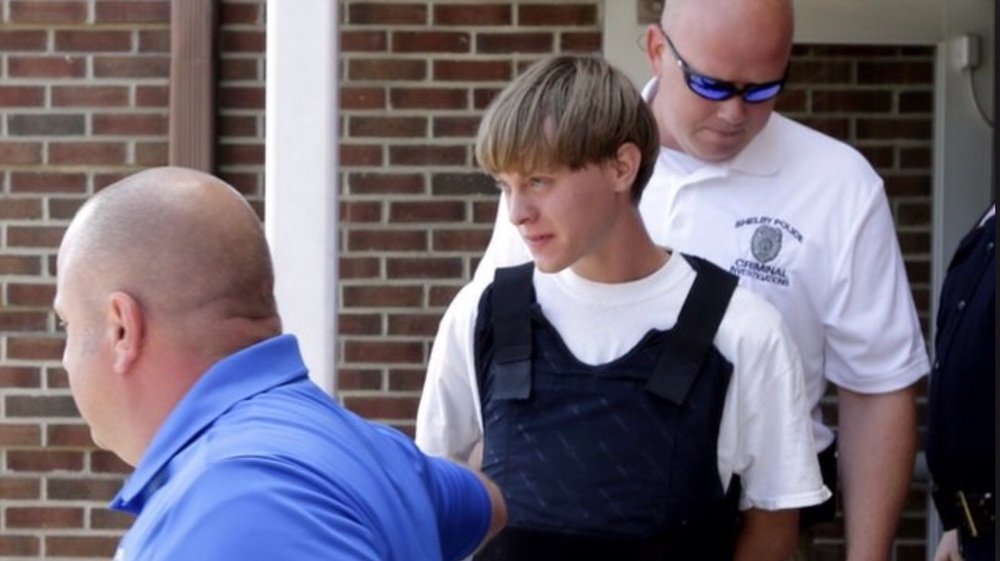 Dylann Roof is arrested by police officials who appear calm, relaxed, and unthreatened by him, although he was found armed. They even went as far as to PROTECT him from bullets, as they PRESERVED his life with a bullet proof vest.