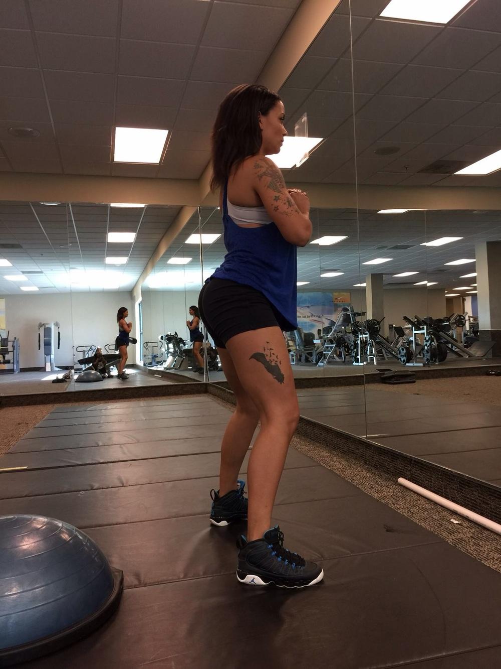 Feet shoulder width apart, then vend into a deep squat.