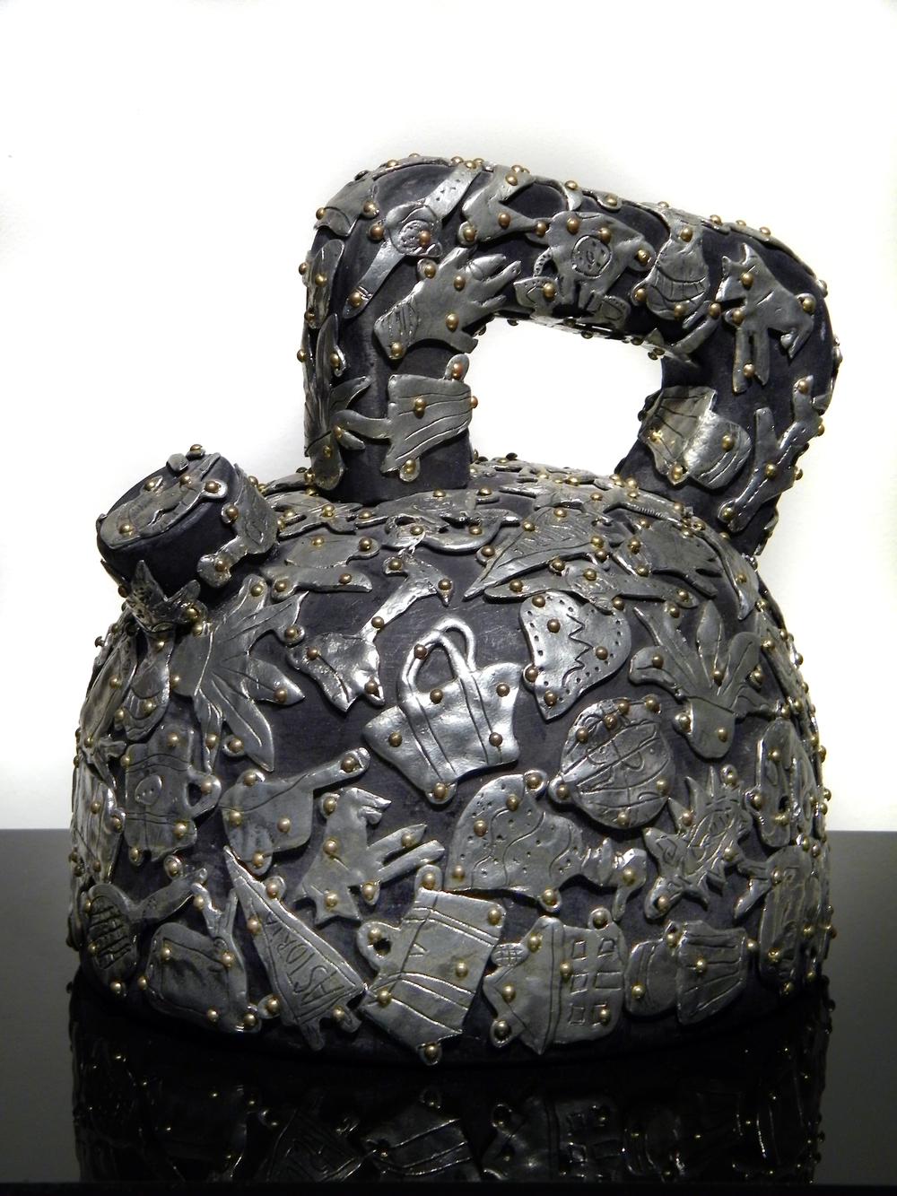 "Claudia DeMonte, ""Female Fetish: Teapot,"" 2006 pewter and brass on wood 9"" x 9"" x 5"""