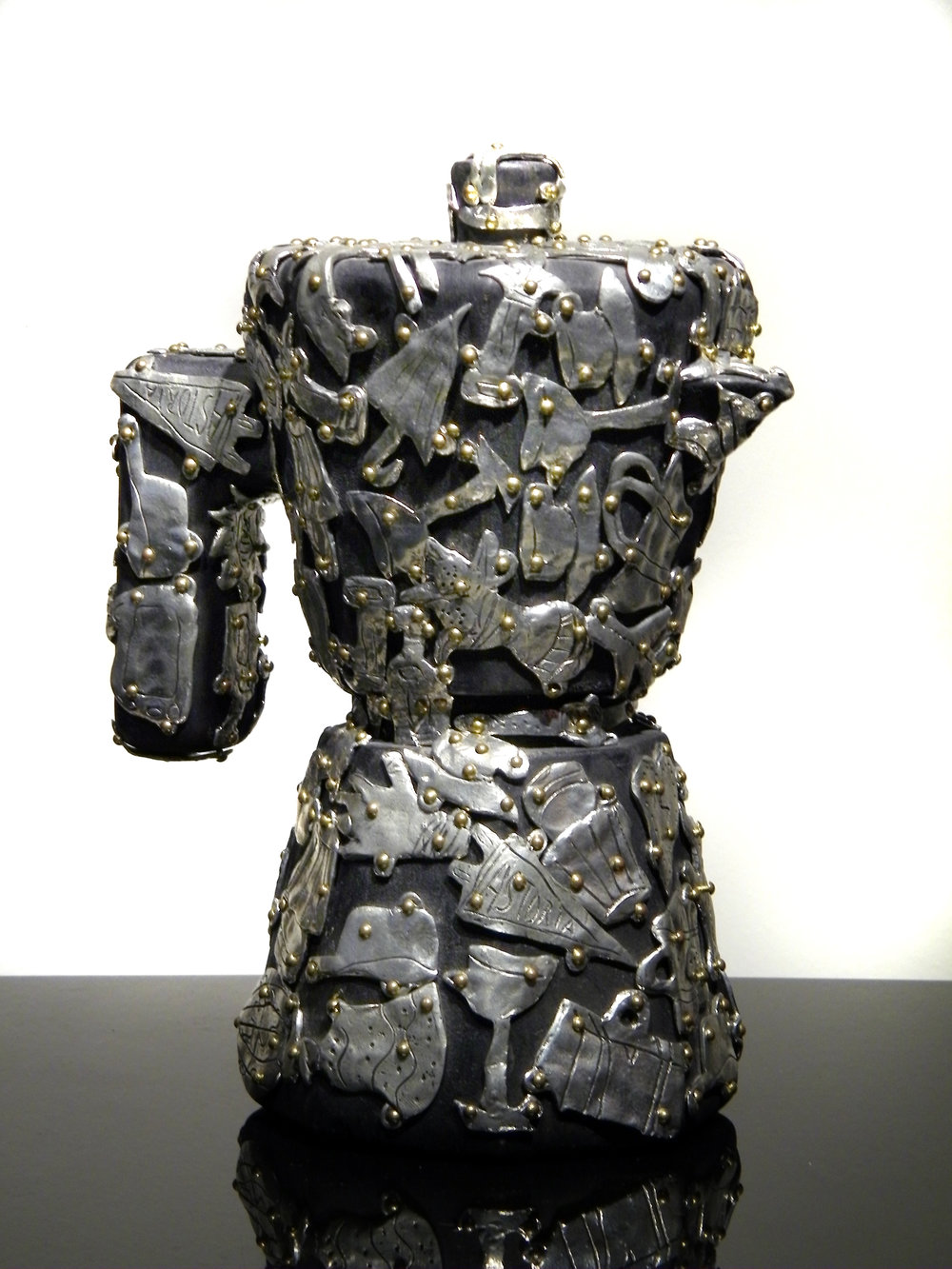 "Claudia DeMonte   (  BIO)       ""Female Fetish: Espresso Pot,"" 2001  pewter and brass on wood  8"" x 8"" x 5"""