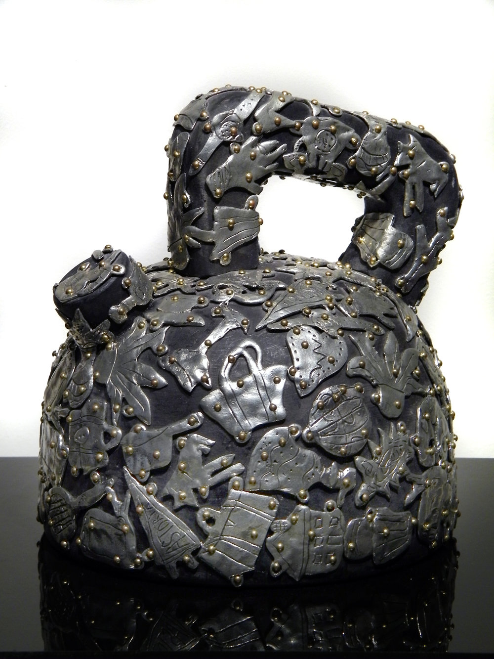 "Claudia DeMonte   (  BIO)       ""Female Fetish: Teapot,"" 2001  pewter and brass on wood  9"" x 9"" x 5"""