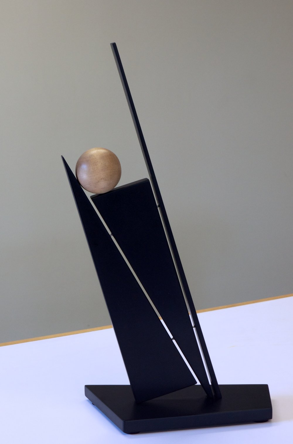 "John Schwartzkopf (BIO) ""Balancing Act,"" 2012 paperstone and maple 21"" x 12"" x 6"""