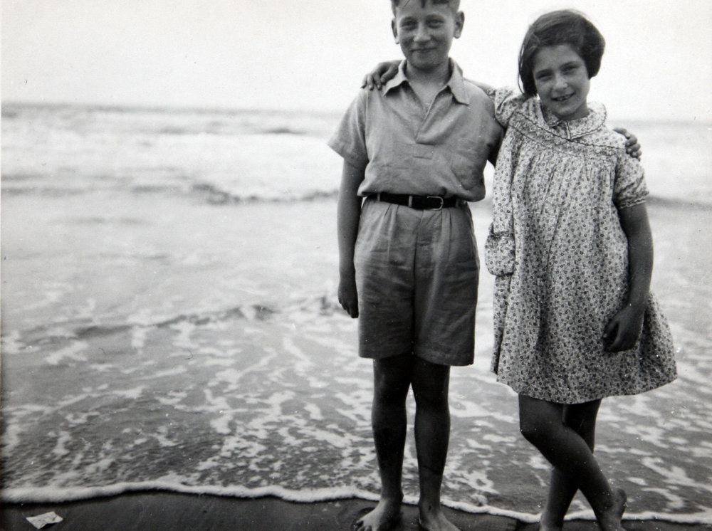 Irene with her brother Werner at the shore, circa 1939.