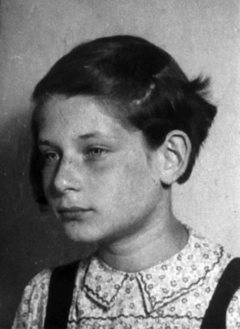 Irene's identity card photo, circa 1943. German identity card photos required that the left ear be visible as an added identity detail.