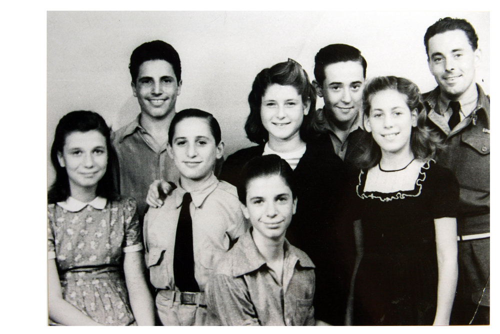 Algeria (1945): Irene (center, standing) with friend, Mieke, to her left and other youth.