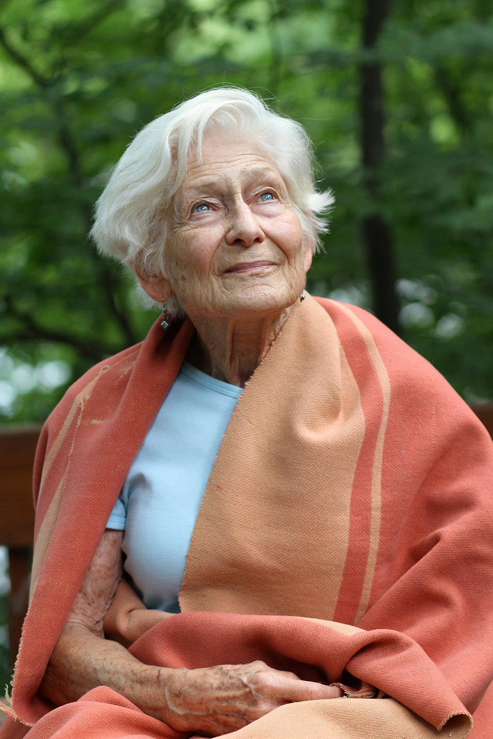 Irene in 2013 with her childhood blanket, the same one she had through Westerbork, Bergen-Belsen, and Camp Jeanne d'Arc in Algeria.