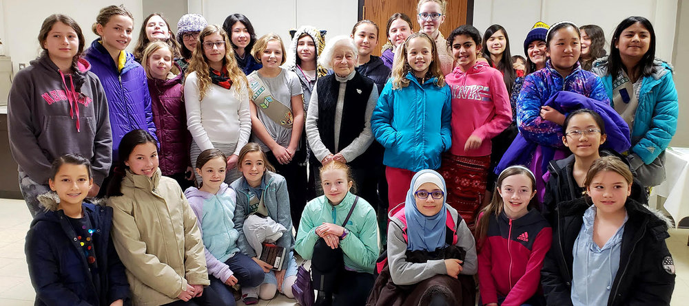 Ann Arbor, MI (Feb. 18, 2019)  - Irene with Girl Scout Troop 45003 after her presentation at the West Side United Methodist Church in Ann Arbor.