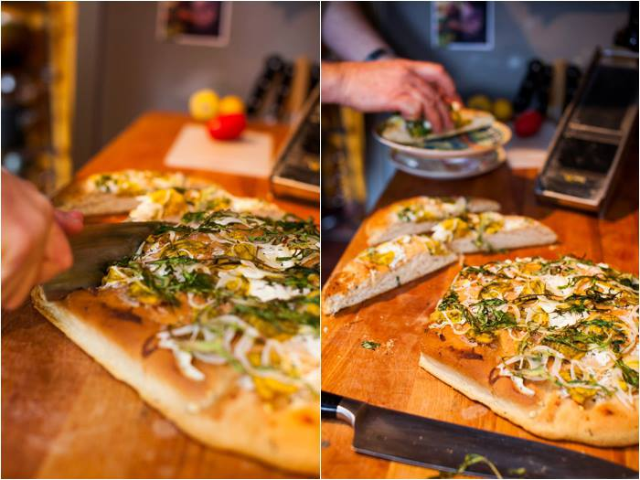 The Thirsty Fork's Christopher Davis-Murai finishes handmade flatbreads with caramelized onion, shaved grana padano cheese, and fresh basil in the Sacramento kitchen