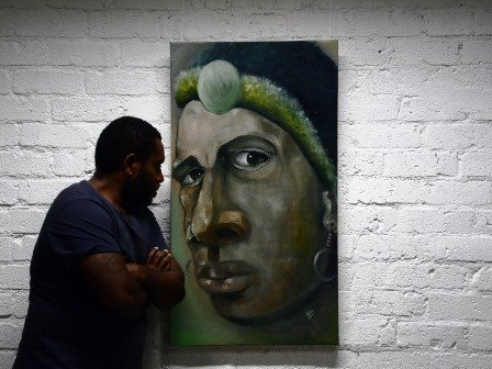 The artist with his recently finished portrait,  One Last Look .