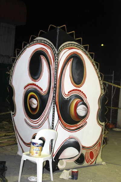 This is one of four stage corners constructed out of bamboo, cane and calico with recycled tyre tubing for fastening. The finished pieces were place on the four corners of the main stage. The subject matter for this works were inspired by traditional masks from around Papua New Guinea