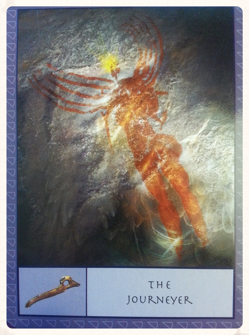""""""" THE JOURNEYER CARD REPRESENTS THE SEEKER DURING A READING. IT'S SYMBOL IS A MAGICAL STAFF PIERCED WITH A HOLE, THROUGH WHICH THE SHAMANS OBTAINED A VIEW INTO THE WORLD OF SPIRIT."""" - p. 8 from the Guidebook"""