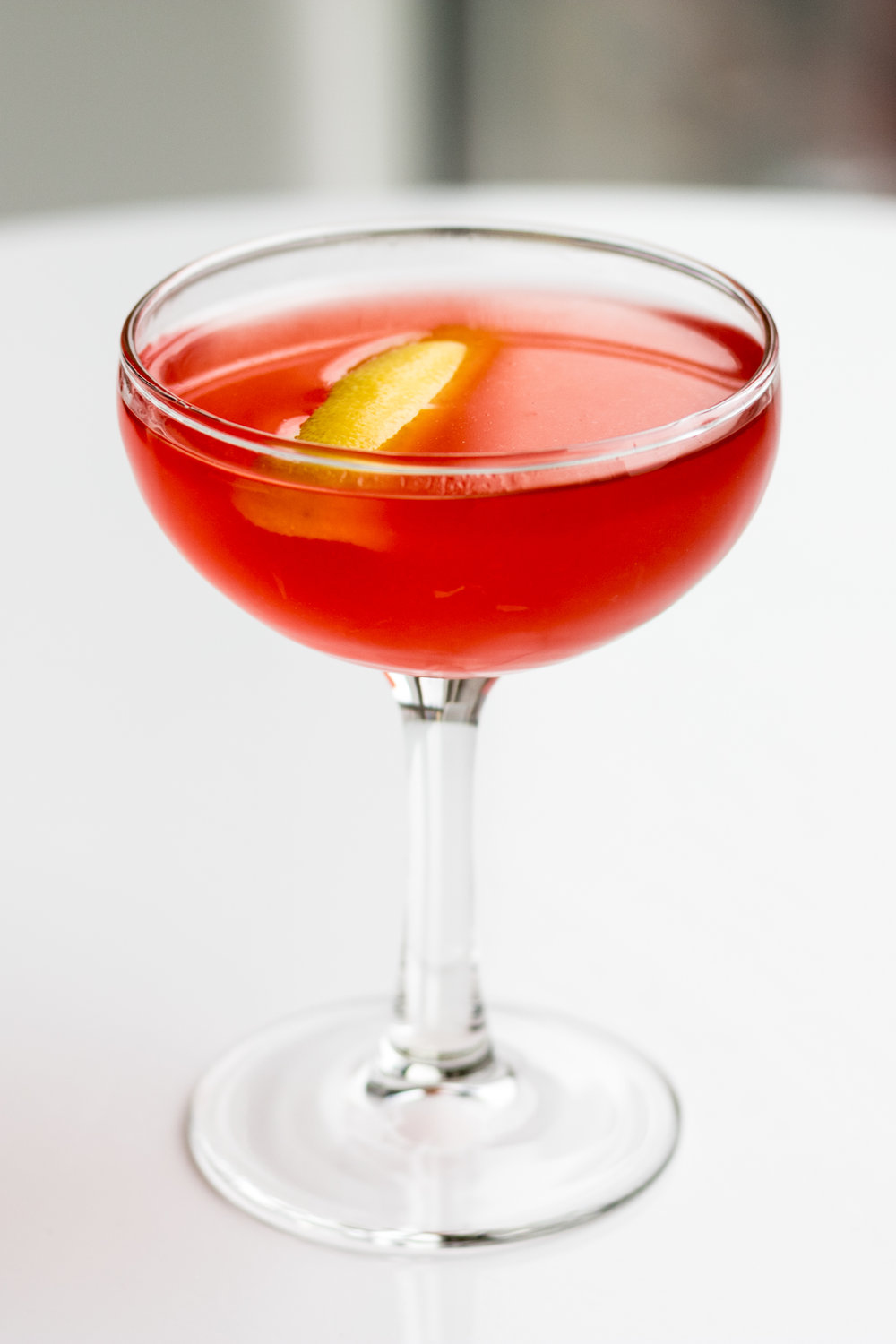 The Jasmine - 1 oz Gin3/4 oz Campari3/4 oz Fresh lemon juice1/2 oz Triple sec