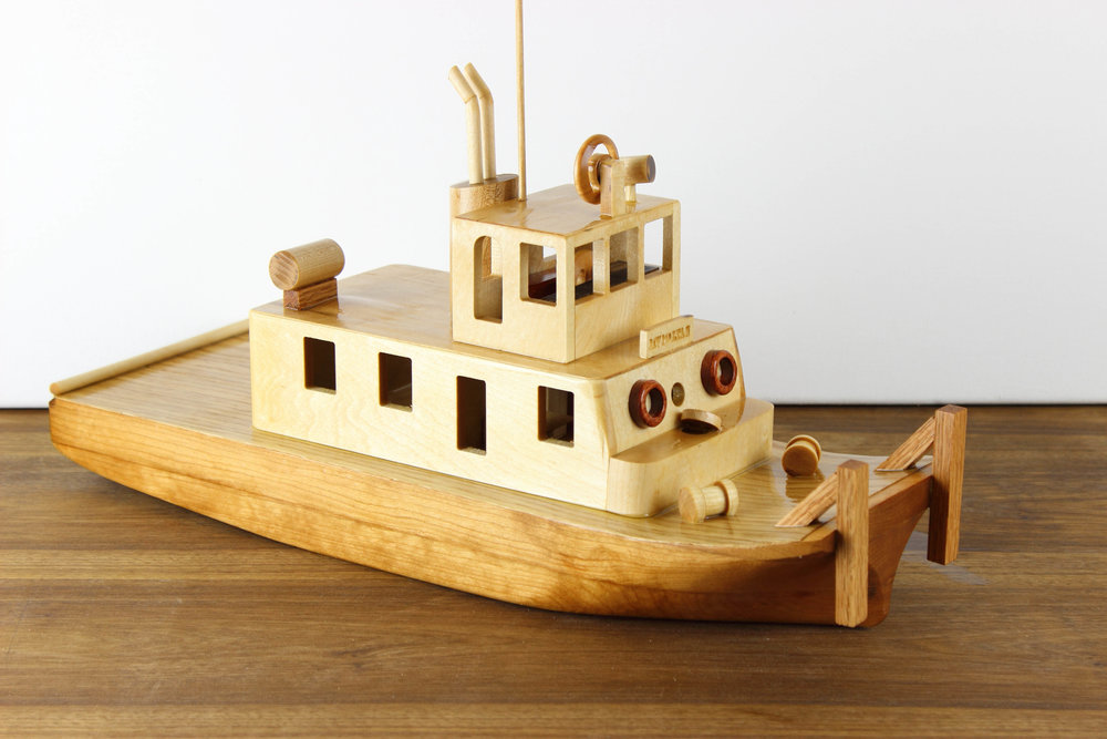 Hand carved hull, boat model created from photos provided.