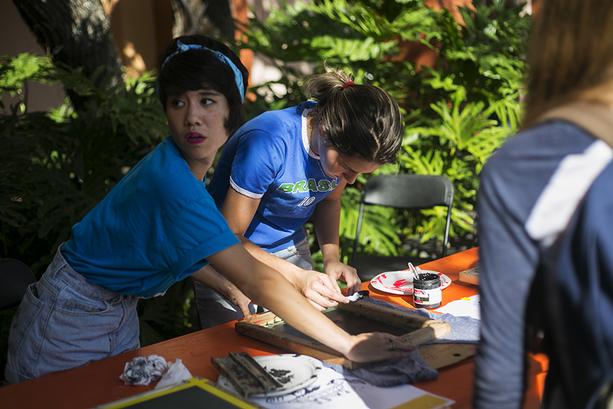 During the  What a Relief  fundraiser event at Ringling College, students make screen prints.  © Karen Arango
