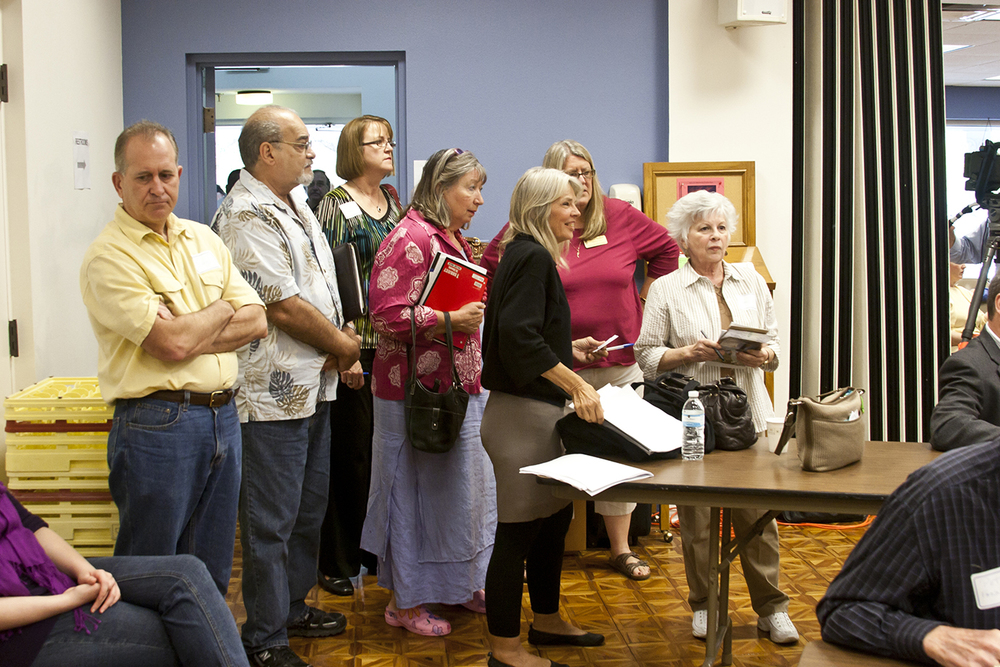 People arrive at the  Suncoast Partnership to End Homelessness event .  © Karen Arango