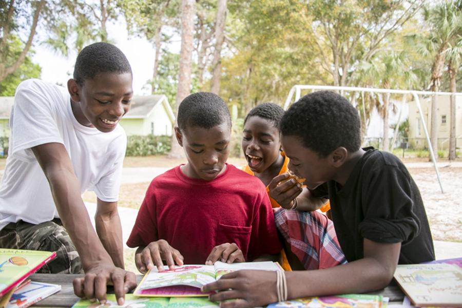 Kids have fun reading during the event for Sarasota Community Studio's participation in the Big League Readers Challenge.  © Karen Arango