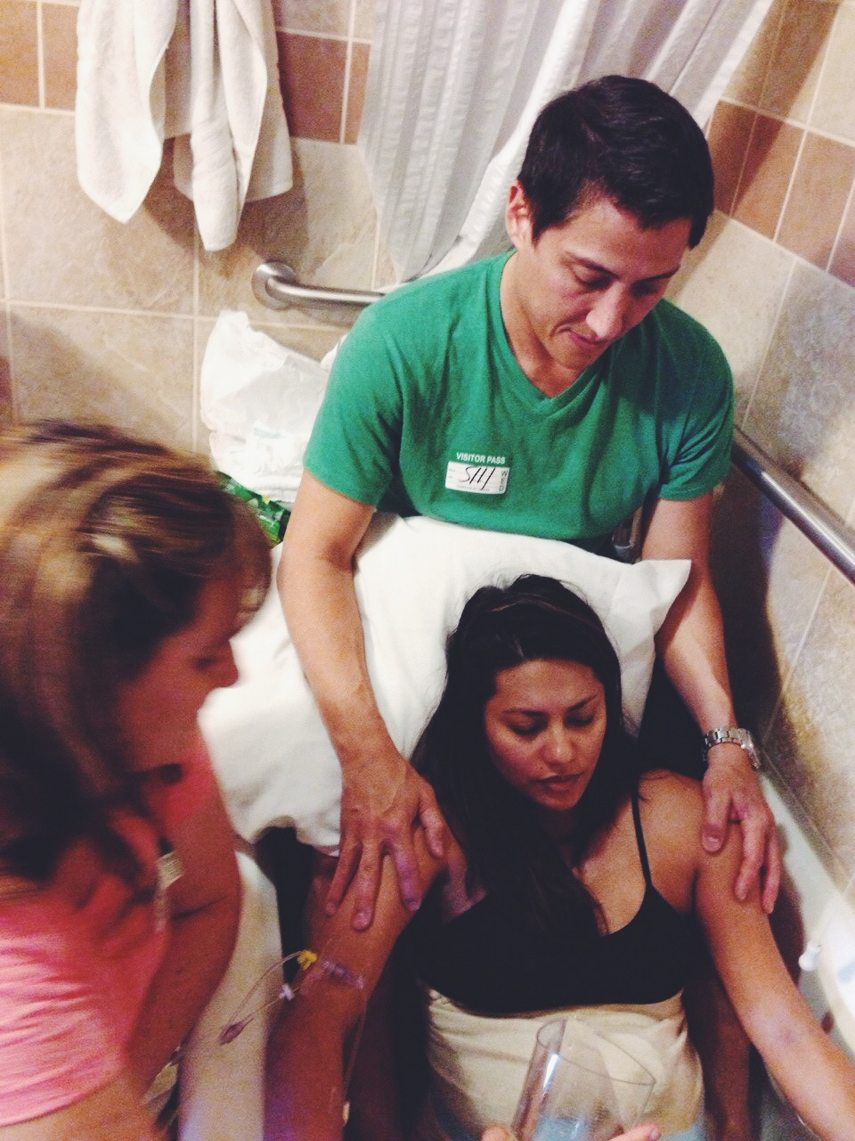 My doula Laura and my husband Sal coaching me through my contractions in the tub.