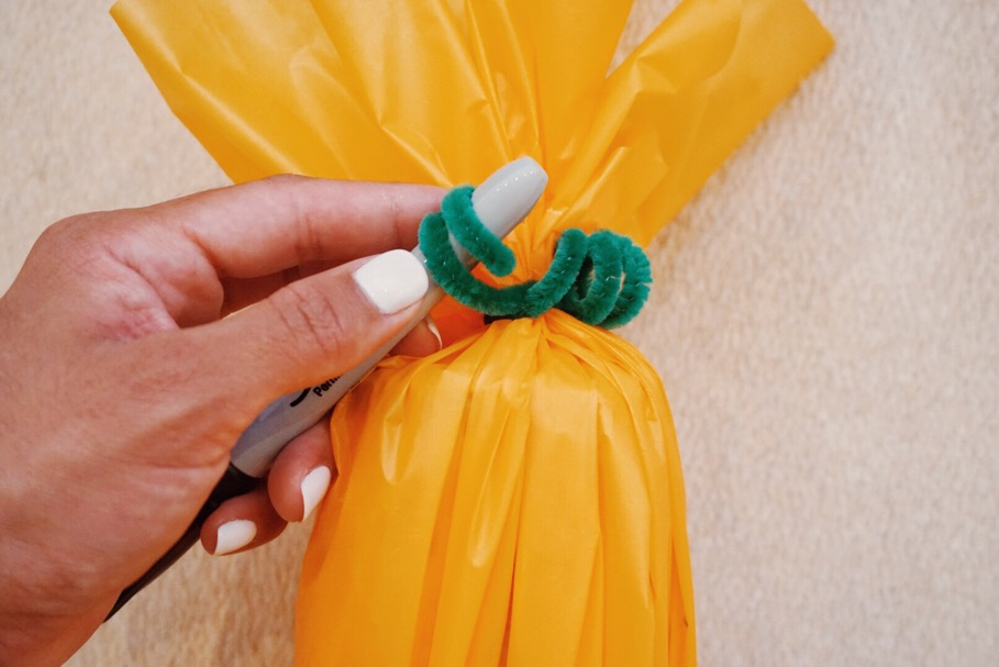 Using the end of your pen, wrap the fuzzy stick around it to create little curls for the pumpkin leaves.