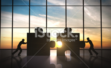 stock-photo-44718556-business-teamwork-puzzle-pieces.jpg