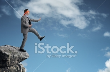stock-photo-30486930-stepping-off-a-cliff-ledge.jpg