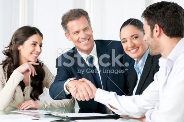 stock-photo-15195325-businessmen-shaking-hands-as-colleagues-smile.jpg