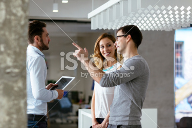 stock-photo-46645466-coworkers-talking-in-a-office-corridor.jpg