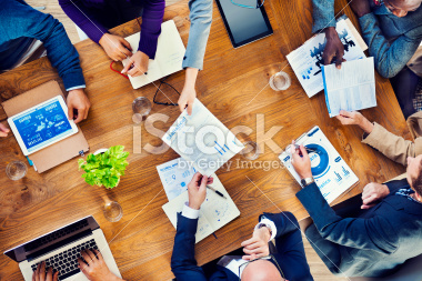 stock-photo-41876160-papers-are-passed-in-a-business-meeting.jpg