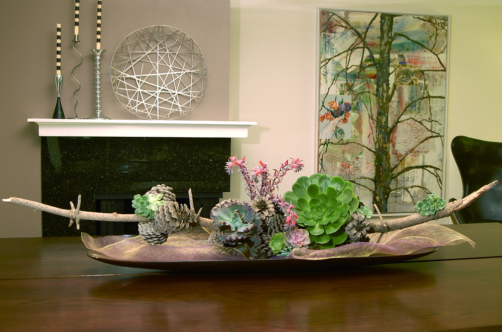 Pinecone Branch with Succulents In An Elongated Wooden Bowl